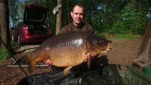 Sławomir Machola z karpiem 21,8kg